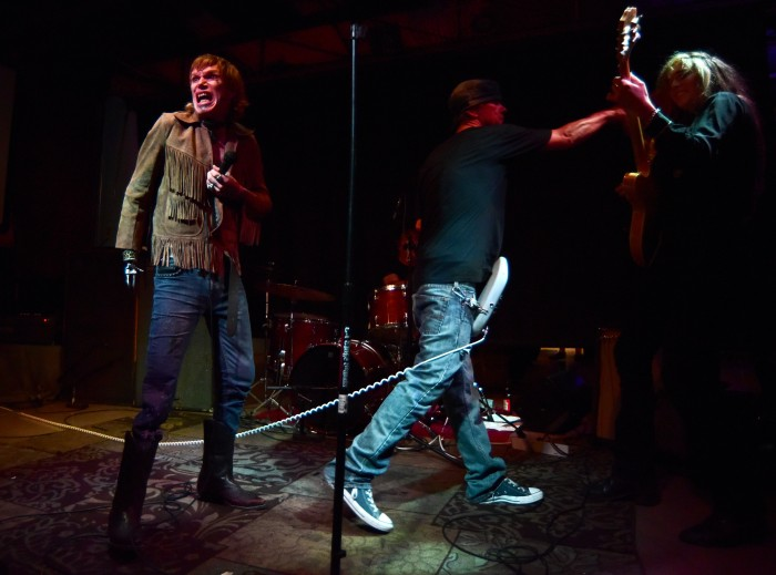 Singer Terry Trash makes a face to the crowd while bassist Ken Andree messes with guest guitarist Annie Dolan.